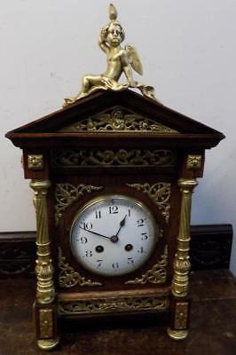 french oak and brass cased striking mantel clock