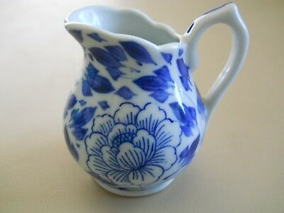 "Small Creamer White w/Blue Flowers and Leaves 2 7/8"" High"