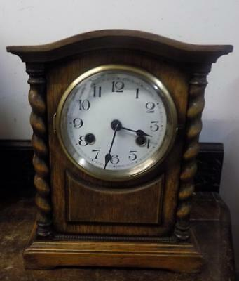 barley twist oak cased striking  mantel clock