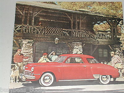 1948 Studebaker advertisement, STUDEBAKER Starlight Coupe, log hunting lodge
