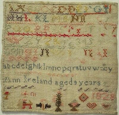 Small Early 19Th Century Motif & Alphabet Sampler By Ann Ireland Aged 9 - 1828