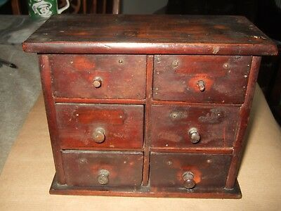 Old wooden six drawer box used for watchmakers spares.