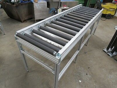 Job lot of assorted heavy duty package handling roller tables conveyors