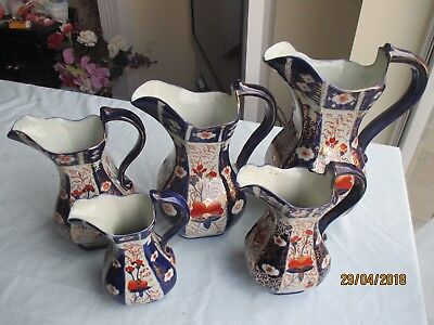 "Complete Set of 5 x Graduated ""Gaudy Welsh"" Ironstone Jugs"