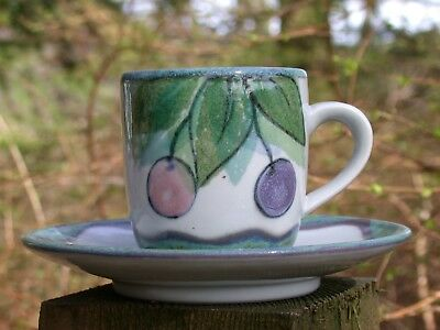 A HIGHLAND STONEWARE cup & saucer - WILD BERRIES pattern - signed