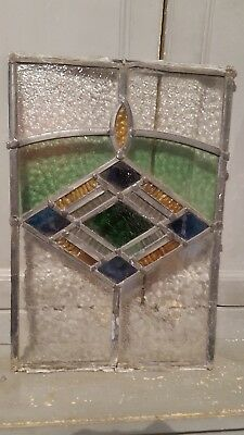Old piece of stained glass spares repairs