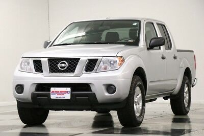 Nissan Frontier SV 4WD Crew Cab Brilliant Silver Truck For Sale 2013 SV 4WD Crew Cab Brilliant Silver Truck For Sale Used 4L V6 24V Automatic