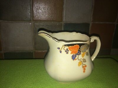 Royal staffordshire A J Wilkinson Honeyglaze Leda milk Jug Creamer art deco