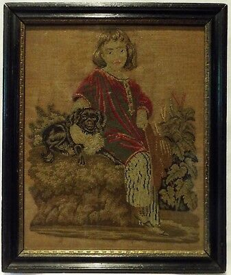 SMALL MID 19TH CENTURY NEEDLEPOINT OF A YOUNG BOY WITH HIS PET SPANIEL - c.1860
