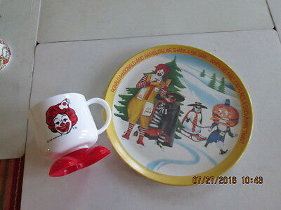 2 McDonalds collectibles 1 1985 footed cup/mug 1 1977 plastic? plate