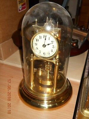 A torsion pendulum 400 Day clock with glass dome