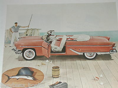1955 LINCOLN advertisement, Lincoln CAPRI, pink convertible on dock, marlin