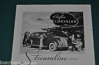 1934 Chrysler AIRFLOW advertisement, streamlined auto, with Ford Trimotor plane