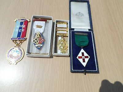 4  Masonic Medals Various Lodges Etc In Boxes Or Pouch Sleeves.