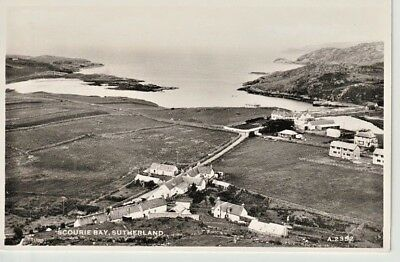 RP Early SCOURIE BAY, Sutherland - aerial view showing houses, road, fields, bay