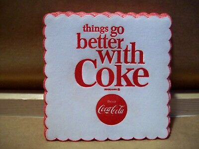 Lot of 20 1960's embossed Coca-Cola paper coasters, things go better with Coke.