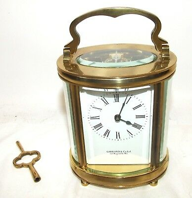 GARRARD & Co 112 REGENT St.  Brass OVAL Carriage Clock Timepiece & Key : WORKING