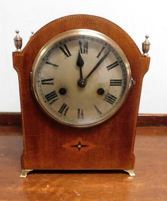 mahogany inlaid striking mantel clock