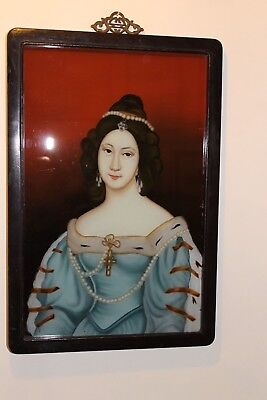 A vintage Chinese reverse painted portrait on glass.