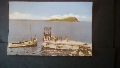 Scotland,Berwickshire,Craigleith and Jetty,boat and people.Vintage postcard.