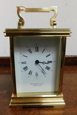 a large brass cased carriage timepiece clock