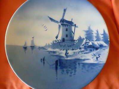 A LARGE BLUE AND WHITE DECORATIVE PLATE WITH WINDMILLS etc