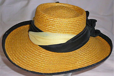 Vintage yellow and black well-made Italian straw hat. Twisted sash.