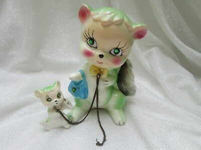 Vintage Green Skunks Mom and Baby on a Chain Ceramic Figurines