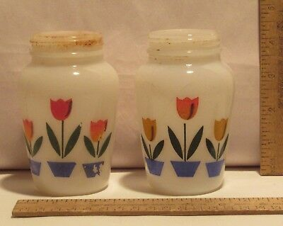 WHITE GLASS with TULIP pattern - SALT and PEPPER SHAKERS - one damaged / no lid