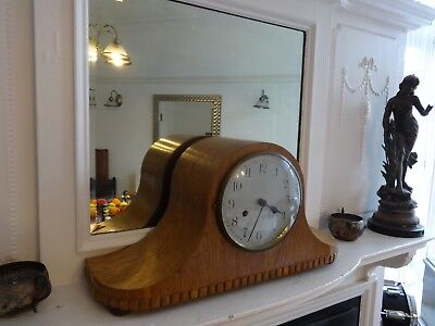 Antique Light Oak Cased Napoleon Hat Striking Mantel Clock with nice curves.