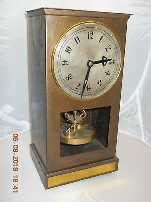 Unusual brass cased anniversary torsion pendulum 400 Day clock by Jfk