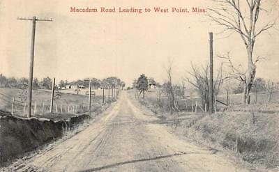 MACADAM ROAD LEADING TO WEST POINT MISSISSIPPI POSTCARD (c. 1910)