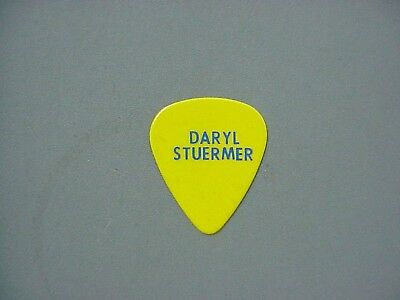 Genesis guitar pick yellow one sided guitar pick Daryl Stuermer