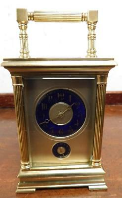 intresting brass cased carriage alarm clock with masked cobalt blue dial