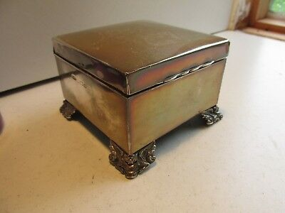 solid silver cigarette box with griffin? feet