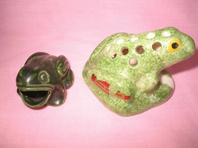Two little Green Frogs - one is a flower frog