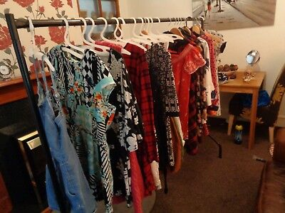 clothes wholesale NEW AND USED MOSTLY NEW 10 - 12 SIZE WIFE HAVING A GOOD CLEAR