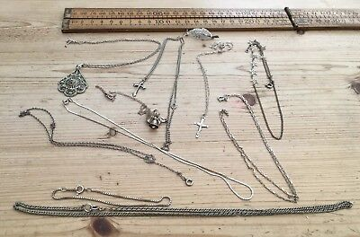 A Collection Of Vintage Silver Necklaces And Pendants