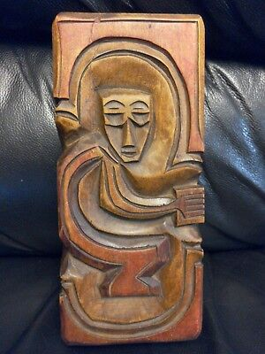 Hand carved lidded wooden box. Oblong. Carved figure on lid. Chile
