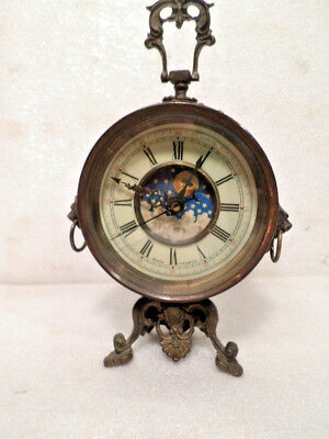 Ornate Moon Dial Carriage Clock With Handle