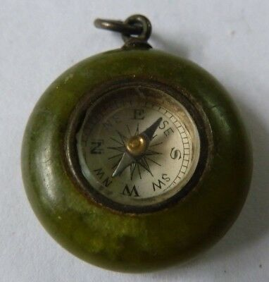 antique compass in green stone