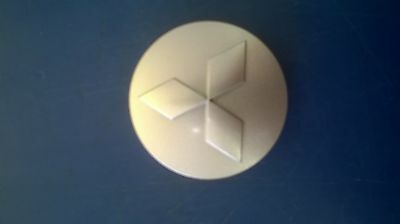 GENUINE MITSUBISHI WHEEL TRIM / CENTRE CAP- OUTLANDER DIESEL RE AND PHEV 2014 on
