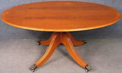Regency Style Yew Wood And Mahogany Oval Tilt Top Coffee Table