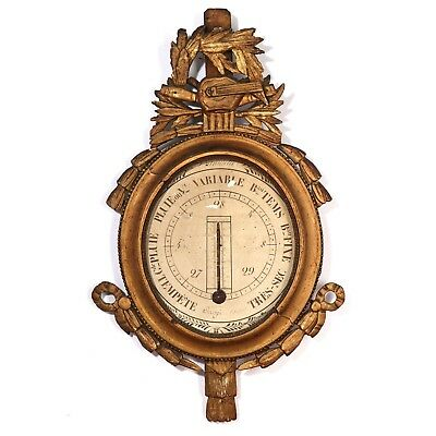 A late 18th century French Louis XVI gilt wood barometer. H. 84. W. 52 cm