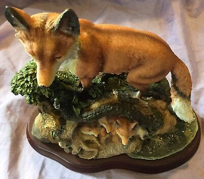 Mom and Cubs Red Fox Figurine In Den