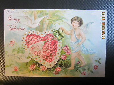 vintage VALENTINE postcard CUPID WATERING a DAISY ROSE HEART DOVE used