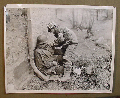Wwii Us Army Signal Corps Photo – Medic With Painted Helmet Tends To Soldier