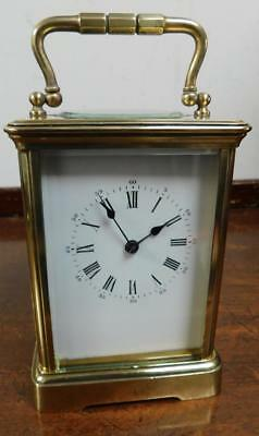 large brass cased striking carriage clock