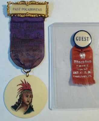 Two Antique Advertising Pocahontas Celluloid Badge & Blackfoot Tribe Badge