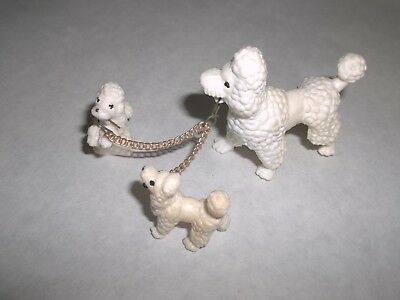3 Plastic Poodle Dogs On a Chain